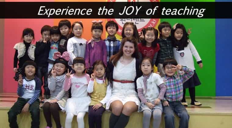 a TEFL teacher surrounded by smiling kindergarteners in Korea