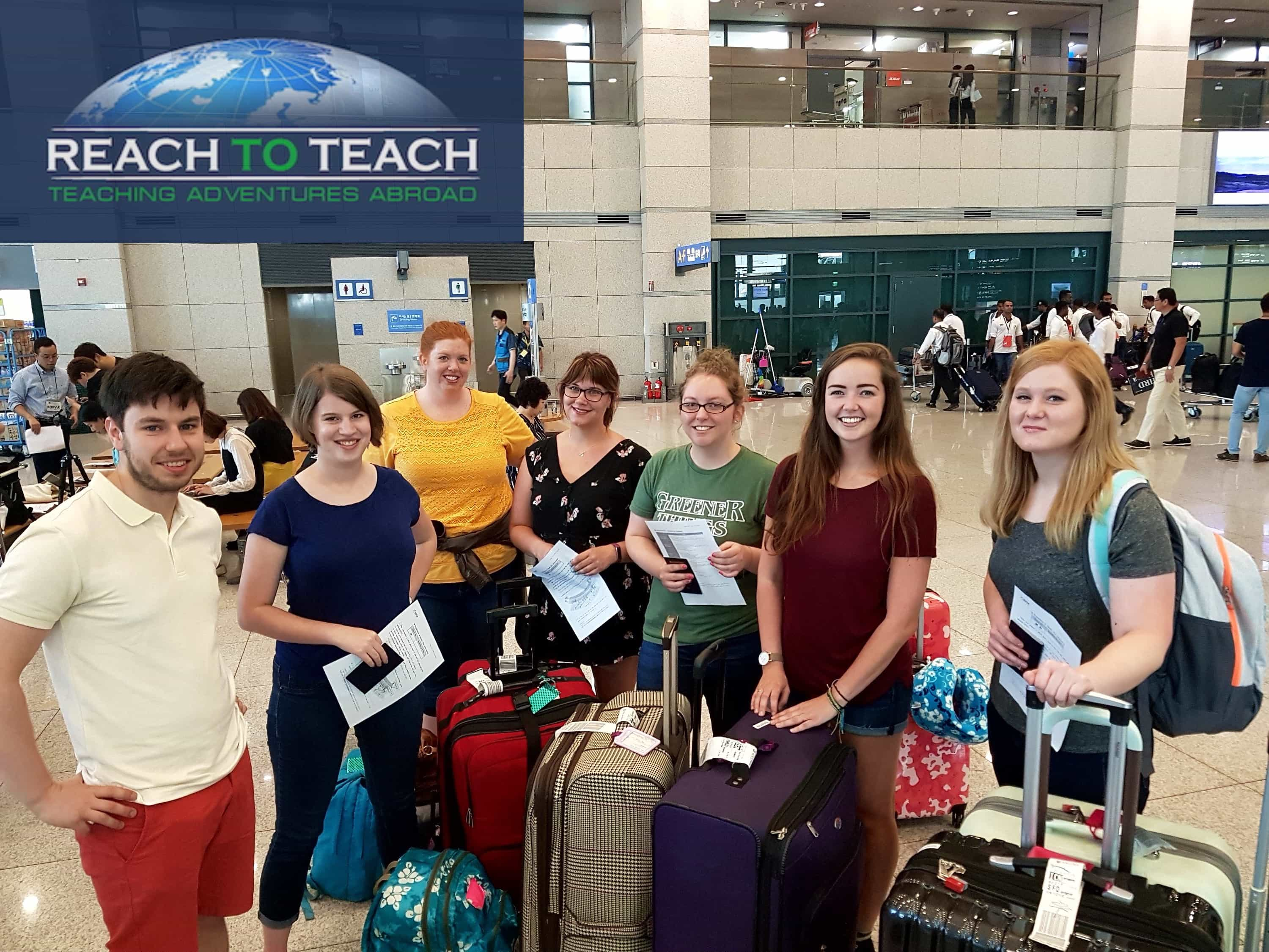 a group of new TEFL teachers arrived at the airport with reach to teach